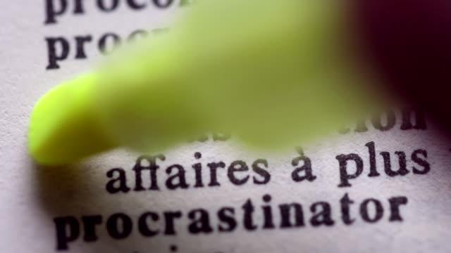 Highlighting the word PROCRASTINATION definition. Signaling the meaning of procrastination video