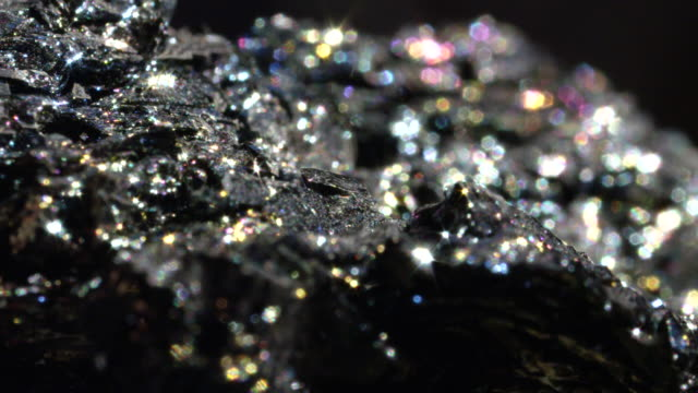 vídeos de stock e filmes b-roll de bokeh: highly sparkling mineral form of iron known as hematite found worldwide - macro