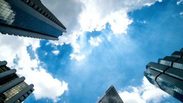 high-rise buildings and blue sky - city abstract stock videos & royalty-free footage
