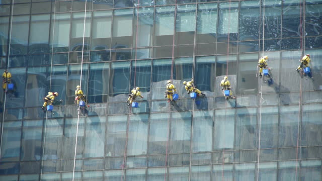 High-rise window cleaners High-rise window cleaners facade stock videos & royalty-free footage