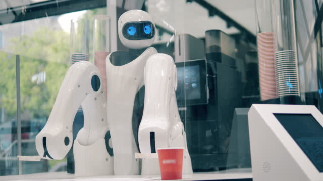 High-tech droid is serving a cup of coffee in a cafe. Innovation, modern technology concept. video