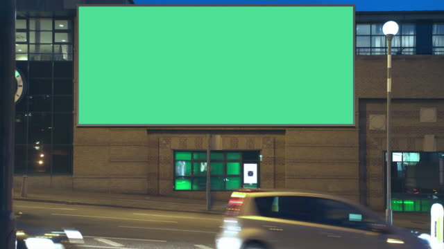 highway advertising building night - insegna commerciale video stock e b–roll