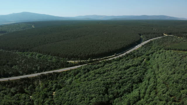 highway and natural landscape near burgos in spain aerial view - strada transitabile video stock e b–roll