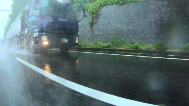 highway driving at rainy day - truck tire video stock e b–roll