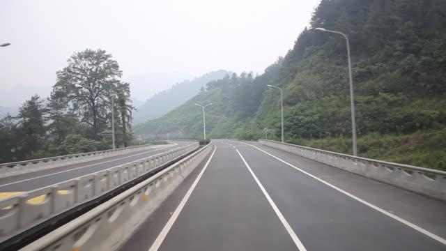 highway driving: short tunnel, descending left turn and bridge video