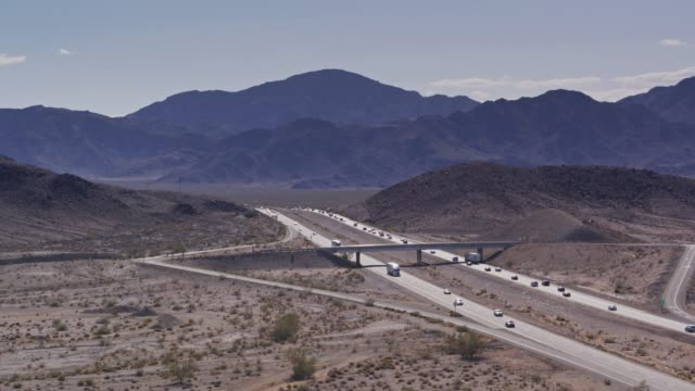 Highway Exit Near Zzyzx, CA - Drone Shot Drone shot of Interstate 15, a divided highway crossing the Mojave Desert near the town of Zzyzx. mojave desert stock videos & royalty-free footage