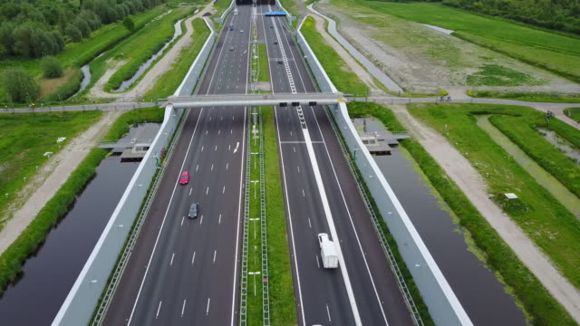 highway in the netherlands, europe. drone shot from cars and traffic passing on - autobahn video stock e b–roll