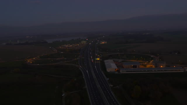 AERIAL Highway intersection at dusk video