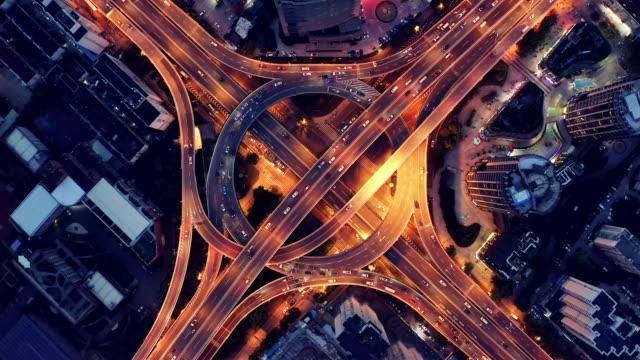 vídeos de stock e filmes b-roll de highway junction aerial view - car view