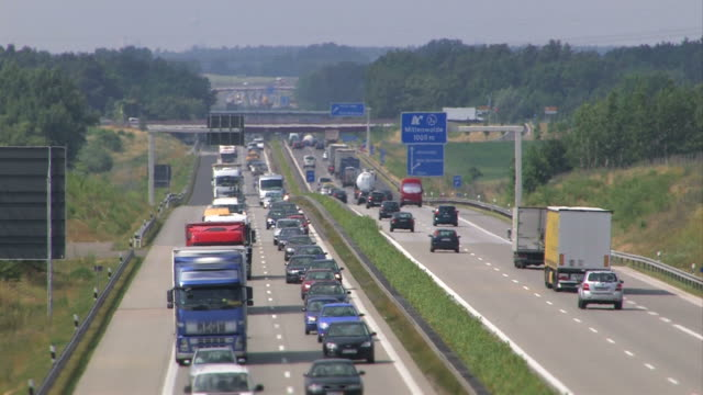 Highway traffic in Germany Highway traffic - Rush hour on a hot day autobahn stock videos & royalty-free footage