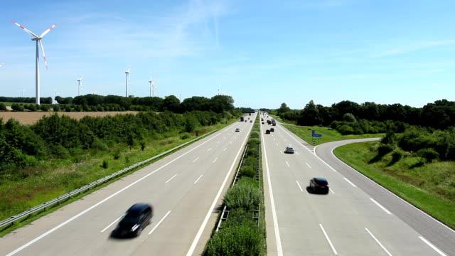 Highway traffic in Germany + wind energy Highway traffic in Germany + wind energy autobahn stock videos & royalty-free footage
