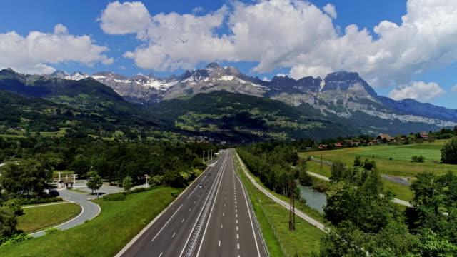 highway traffic of car and trucks aerial drone 4k video - stato federato del tirolo video stock e b–roll