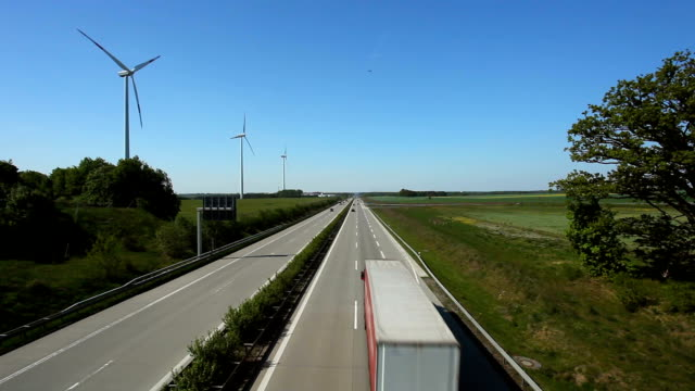 highway traffic with wind energy in germany, real time - autobahn video stock e b–roll