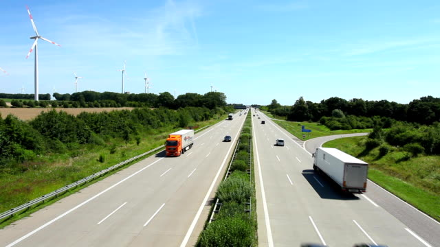 Highway traffic with wind energy in Germany Highway traffic with wind energy in Germany, Time Lapse autobahn stock videos & royalty-free footage