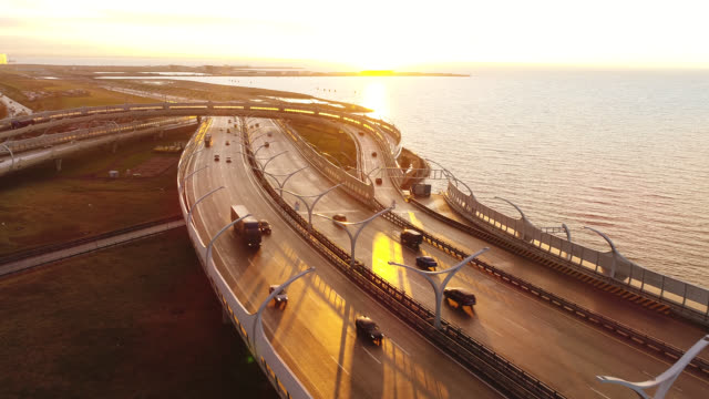 highway high-speed road by the sea On the Sunset double refraction stock videos & royalty-free footage