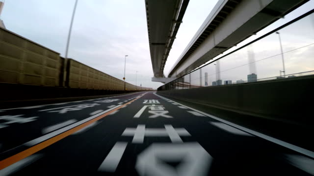 Highway view through Tokyo's beautiful Bay Area structures at twilight. video