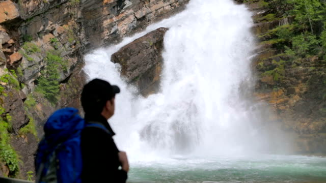 Hiker Admires Beautiful Waterfall video