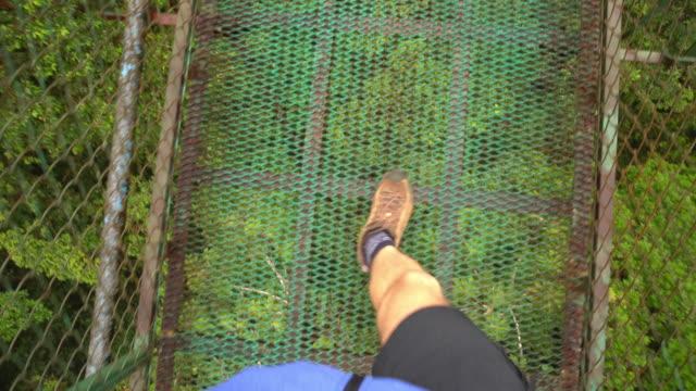 POV Hiker crossing a footbridge video