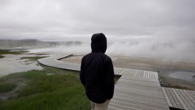 Hiker explores dramatic Icelandic landscapes