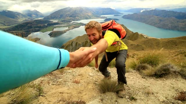 Hiker hiking pulls out hand to get assistance from teammate video