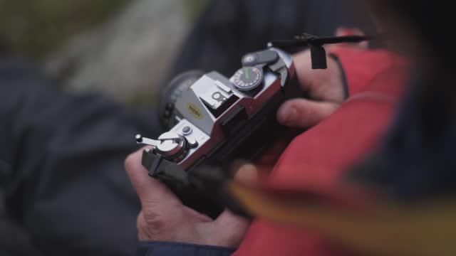 Hiker Holding Vintage Slr Camera