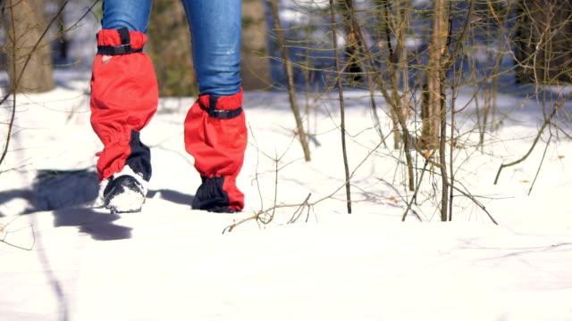 Hiker legs walking through a deep snow. video
