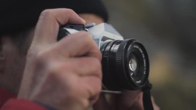 Hiker Looking Through Vintage Slr Camera