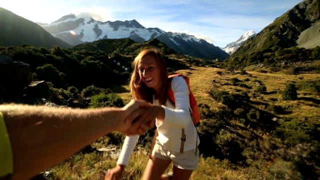 Hiker pulls out hand to get assistance from teammate video