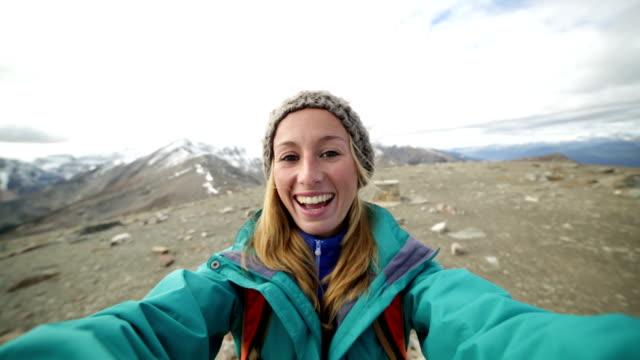 Hiker reaches mountain top, takes 360 degree selfie video