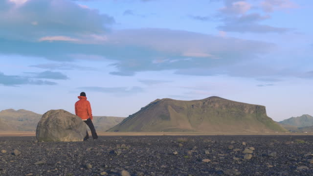 Hiker Resting on a Rock on Iceland video