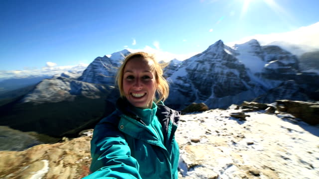 Hiker takes 360 degree selfie on mountain peak video
