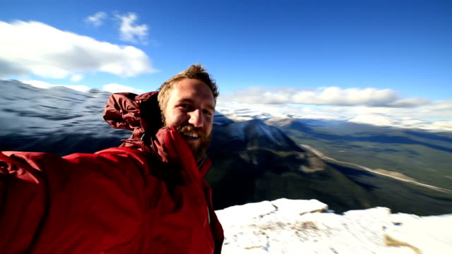 Hiker takes 360 degree view selfie on mountain top video