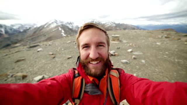 hiker takes 360 degree view selfie portrait video