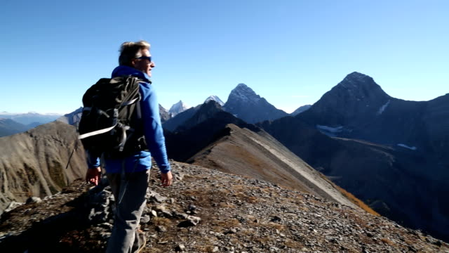 Hiker takes final steps to mountain summit video
