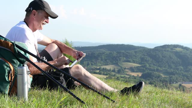 Hiker using digital tablet