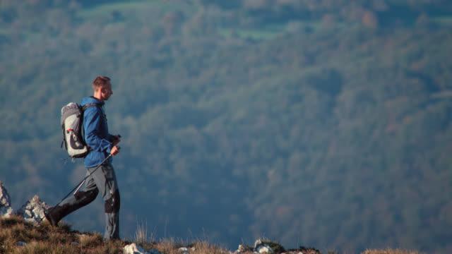 Hiker walking down the mountain video