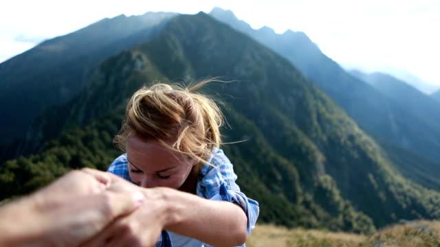 Hiker woman reaching mountain top video