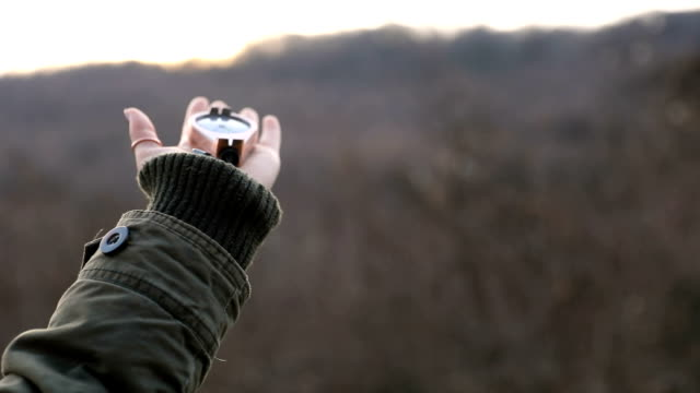 Hiker woman with a compass in the mountains video