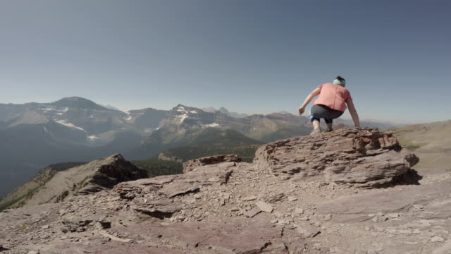 Hikers look out at mountain view  pedal pushers stock videos & royalty-free footage