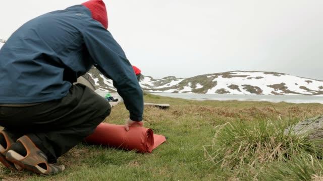 Hikers packs the mat. Norway video