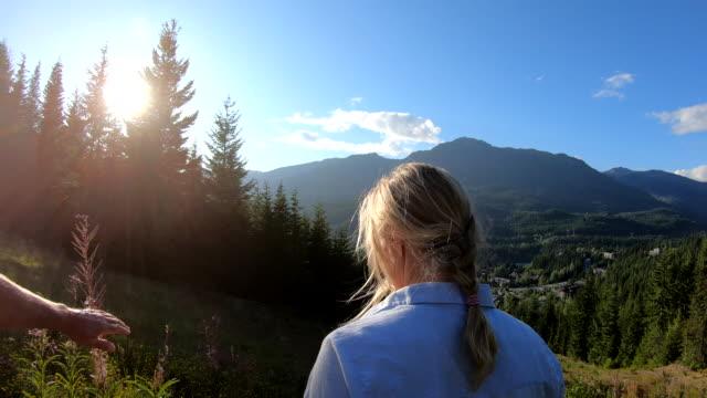 vídeos de stock e filmes b-roll de hiking couple traverse mountain slope at sunrise - 55 59 anos
