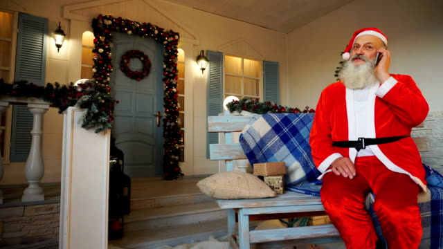 Hilarious Father Christmas calling parents by phone video