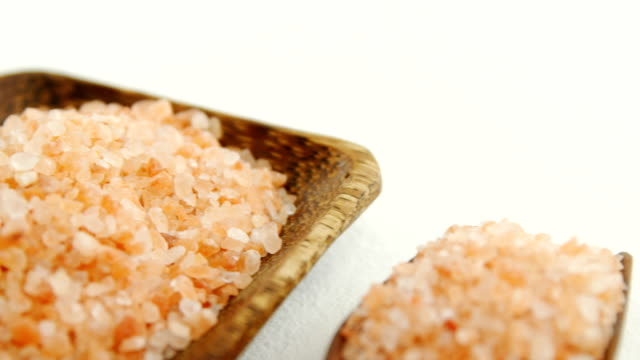 Himalayan salt arranged in wooden bowl and scoop 4k video