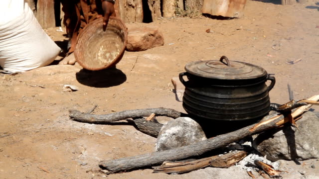 CU Himba Woman Cooking On Open Fire video