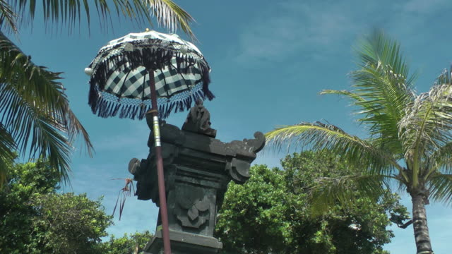 Hindu shrine with the traditional liturgic umbrella