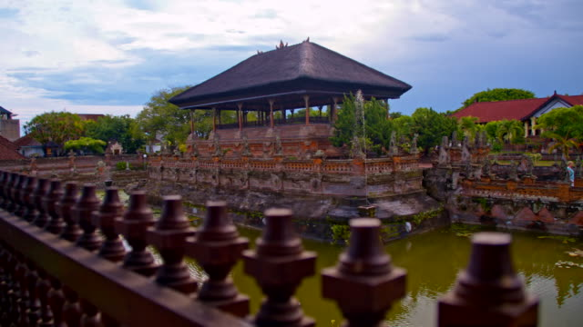 SLO MO Hindu Temple in Bali HD1080p: SLOW MOTION Camera Stabilization shot of a religious architecture surrounding a pond in a hindu temple. Bali. Indonesia. palace stock videos & royalty-free footage
