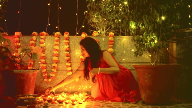 Hindu Woman Lighting Diyas video
