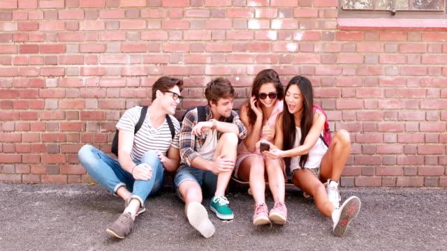 Hip friends using smartphone video