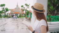 istock Hip Leinster girl standing scribbled something on a notebook while touring the Temple of Dawn. Popular locations in Thailand. 1184615010