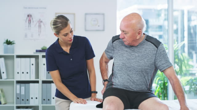 Hip pain is part of the ageing process 4k video footage of a senior man getting examined by a young physiotherapist pain stock videos & royalty-free footage